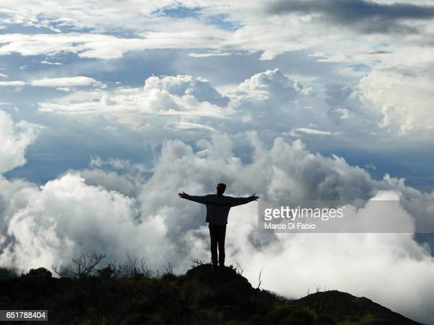 man in the clouds - mount meru stock photos and pictures