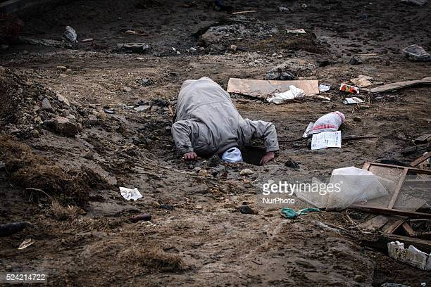 A man in the devastated city of Ishinomaki on April 15 2011 following the deadly March 11 earthquake and tsunami that hit the northeastern coast of...