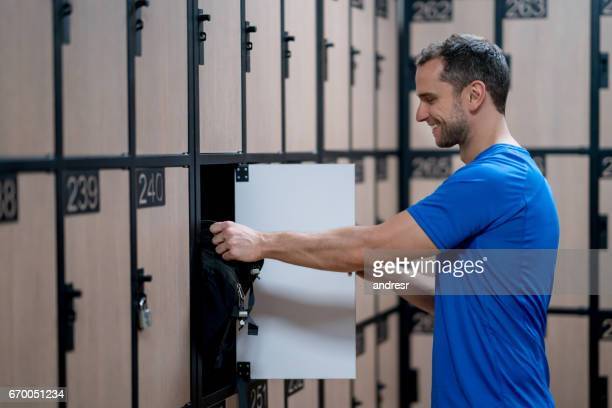 man in the dressing room at the gym - locker stock pictures, royalty-free photos & images