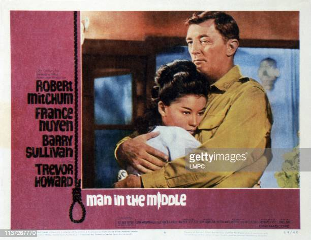 Man In The Middle, lobbycard, , US poster, from left: France Nuyen, Robert Mitchum, 1964.