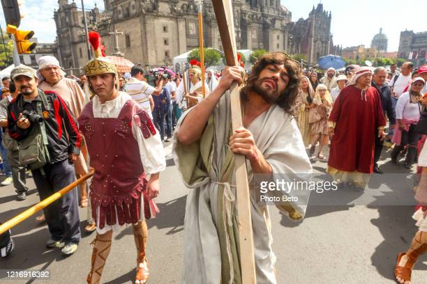 a man in the role of jesus christ in the via crucis during the easter celebrations in mexico city - holy week stock pictures, royalty-free photos & images