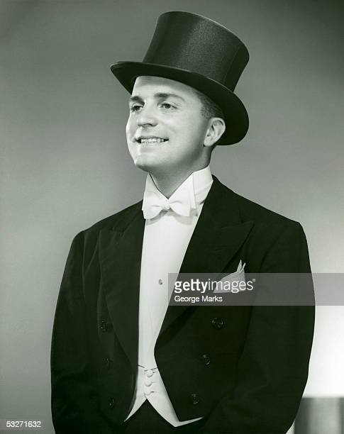 Man in top hat, white tie and tails