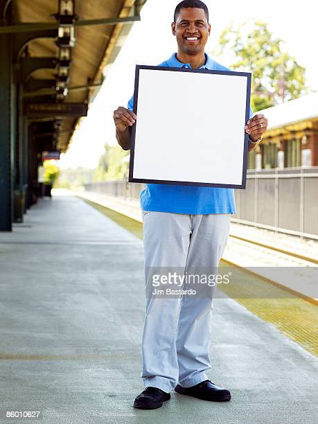 man in town holding sign  - person holding blank sign stock pictures, royalty-free photos & images