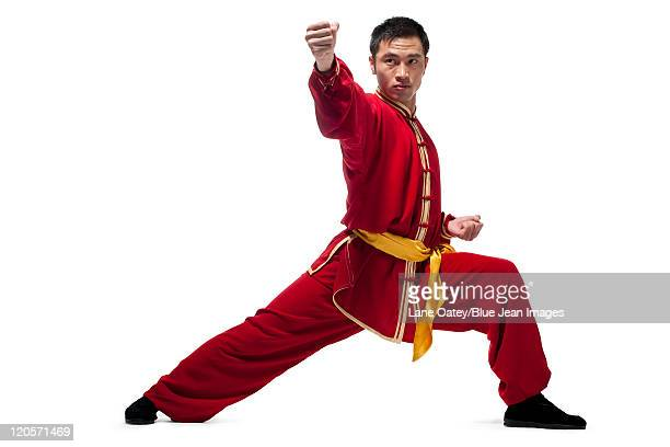man in traditional chinese clothing doing martial arts - kung fu stock photos and pictures