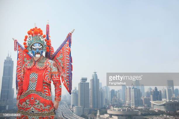 man in traditional chinese opera costume - peking opera stock photos and pictures