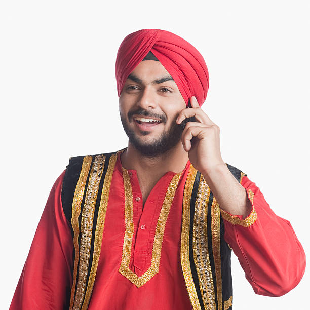 Man in traditional clothing talking on a mobile phone