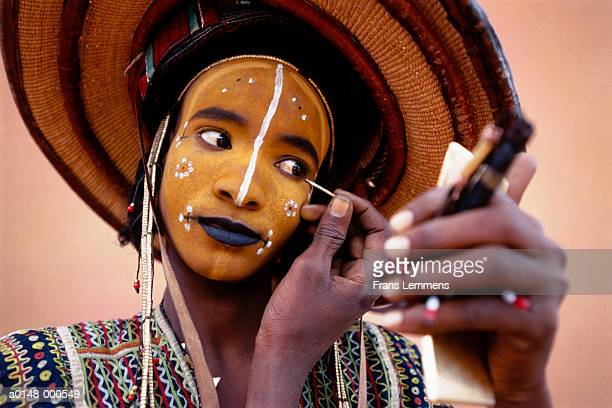 man in traditional costume - african tribal face painting stock photos and pictures