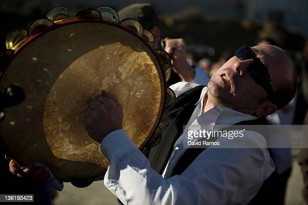 A man in traditional costume plays a tambourine before performing in a traditional Verdiales Flamenco contest on December 28 2011 in Malaga Spain...