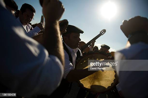 A man in traditional costume plays a tambourine with his 'Panda' as they rehearses before performing in a traditional Verdiales Flamenco contest on...