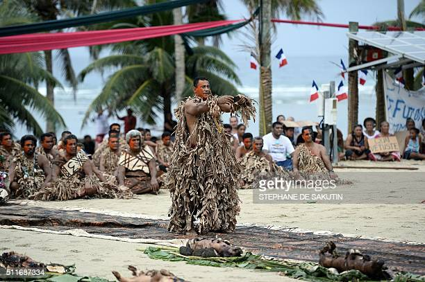A man in traditional costumes performs during a ceremony by 'la grande chefferie du royaume d'Alo' in Futuna island on February 22 2016 in honor of...