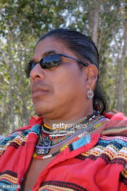 A man in traditional dress at the Big Cypress Shootout event at Billie Swamp Safari
