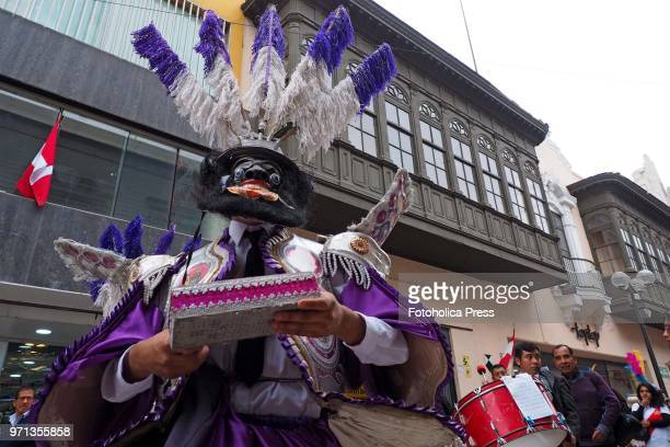Man in traditional dress dancing in the grand parade, in the downtown of Lima, for the 69th anniversary of the National Superior School of Folklore...