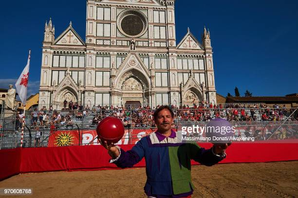 A man in traditional dress holds balls before the semifinal match of The Calcio Storico Fiorentino between the Santa Maria Novella Team and tthe...