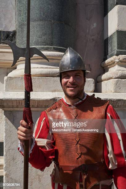 Man in traditional dress march through Florence ahead of the Calcio Storico Fiorentino 2018 semifinal match between the Santa Maria Novella Team and...