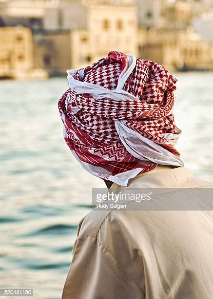 Man in traditional dress on the Dubai Creek water taxi