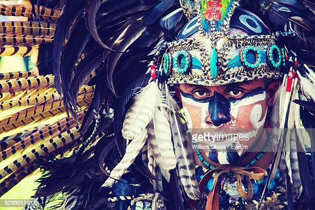 man in traditional indian clothing - aztec civilization stock photos and pictures