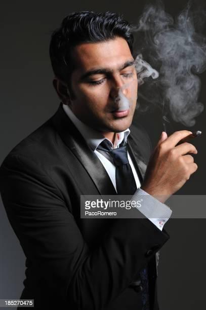 Man in tuxedo smoking
