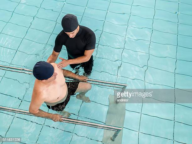 Man in underwater physiotherapy
