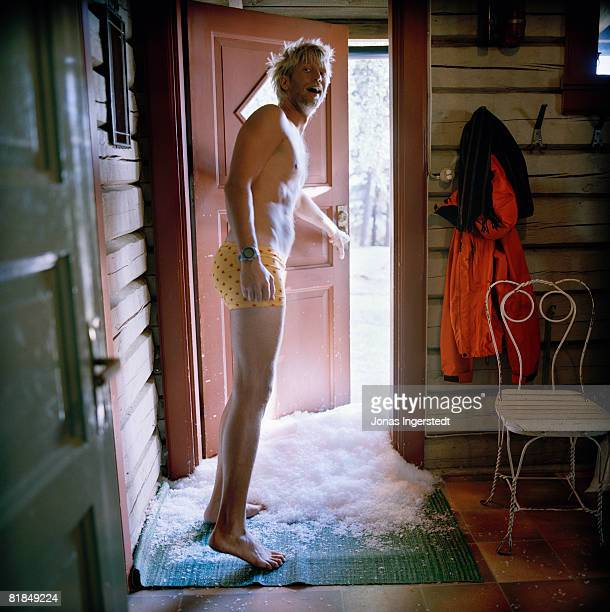 a man in underwear opens a door sweden. - bad luck stock pictures, royalty-free photos & images