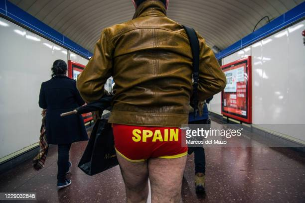 "Man in underwear walking inside the metro during the annual ""No Pants Subway Ride""."
