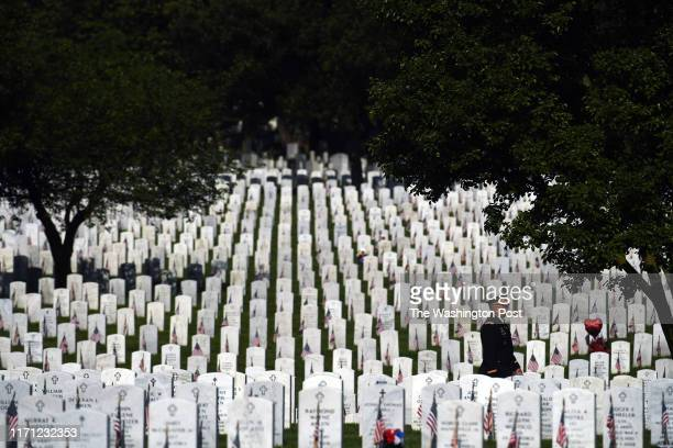 A man in uniform walks through Arlington National Cemetery on Monday May 27 2019 in Washington DC Monday was Memorial Day
