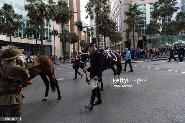 A man in uniform with his horse on April 25 2019 in Sydney Australia Australians commemorating 104 years since the Australian and New Zealand Army...