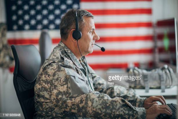 man in uniform working on the computer - us military stock pictures, royalty-free photos & images