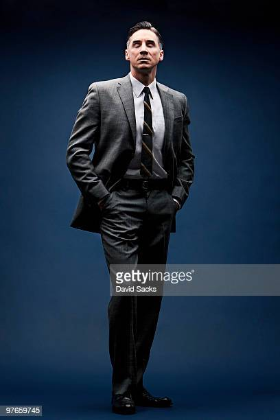 Man in vintage business suit with eyes closed