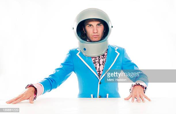 man in vintage tuxedo wearing space helmut - space helmet stock pictures, royalty-free photos & images