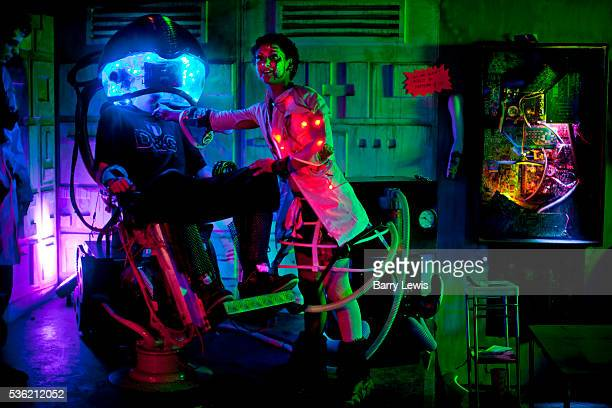 Man in virtual reality machine in a bizarre bar, nano-venue in the Alleys, Shangri-la. Glastonbury Festival 2010