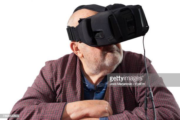 man in virtual reality over white background - head mounted display stock photos and pictures