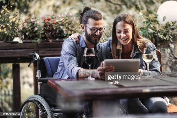 man in wheelchair dating a woman - wheelchair stock pictures, royalty-free photos & images