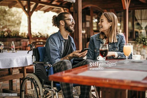 man in wheelchair - wheelchair stock pictures, royalty-free photos & images