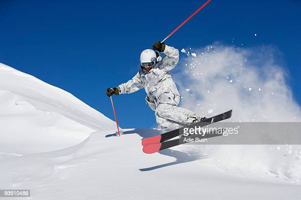 man in white & grey camo suit off-piste. - downhill skiing stock pictures, royalty-free photos & images