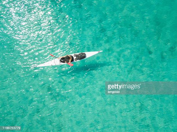 man in white kayak from above - emerald green stock pictures, royalty-free photos & images