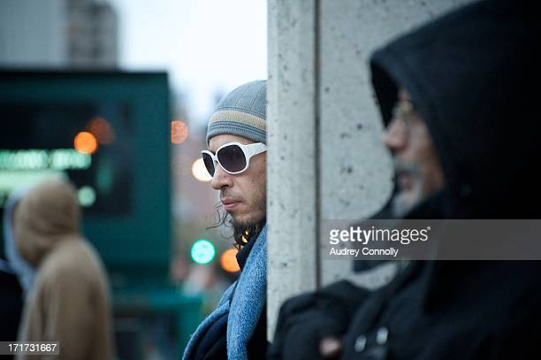 CONTENT] Man in white sunglasses and winter knitted cap outside Union Square Park Manhattan New York City