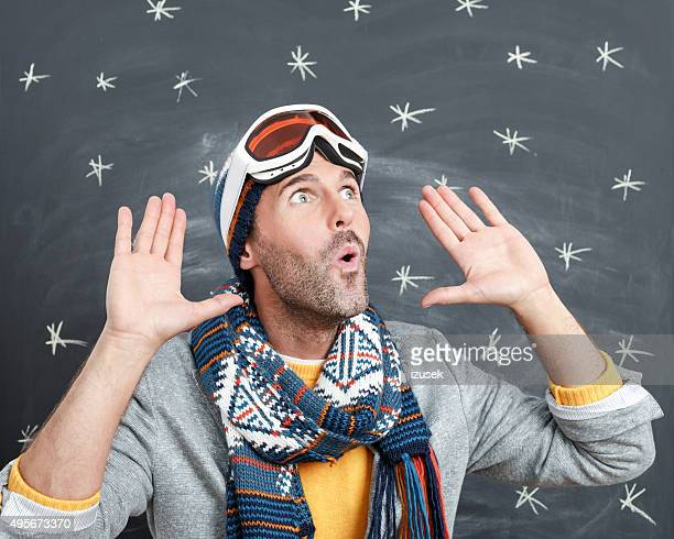 man in winter outfit whistling against blackboard - whistle blackboard stock pictures, royalty-free photos & images