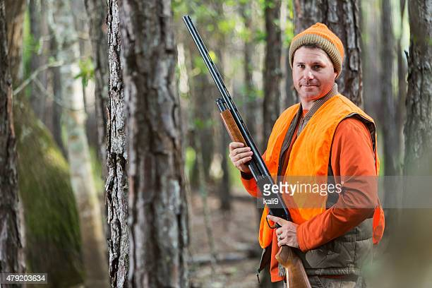 man in woods hunting with shotgun - hunting stock pictures, royalty-free photos & images