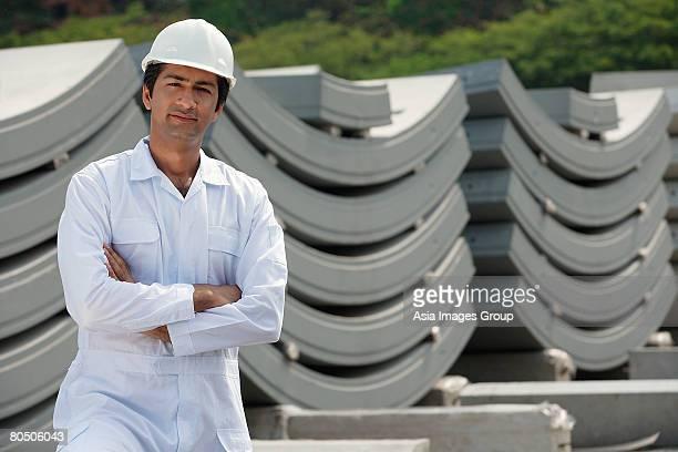 Man in work uniform arms crossed, looking at camera