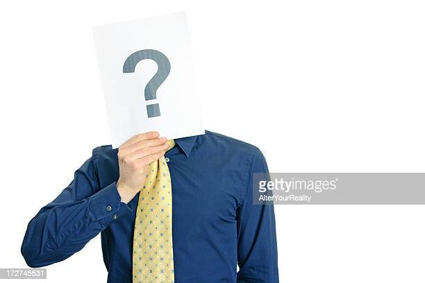 Man in yellow tie holding card with question mark over face