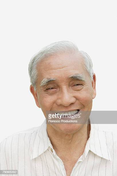 Man indoors smiling