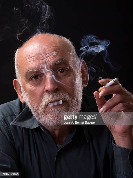 Man inhaling the smoke of a cigarette