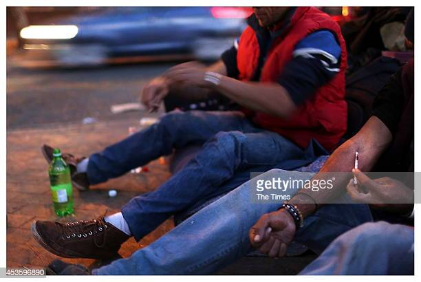 A man injects himself with the extremely addictive drug heroine on August 12 2014 in Pretoria South Africa Members of Moeggesukkel a nonprofit...