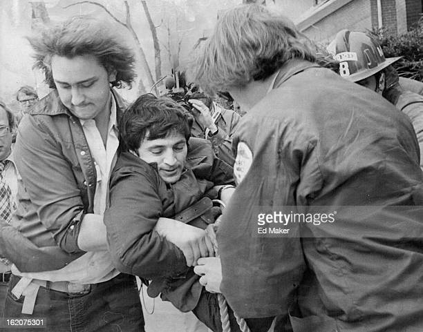 MAR 28 1977 Man Injured In Fall Emmanuel Koumantakis employe of Penn Square Apartments 550 E 12th Ave is carried to an ambulance by Denver *****...
