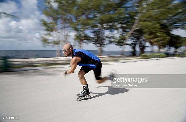 Man inline skating, blurred motion