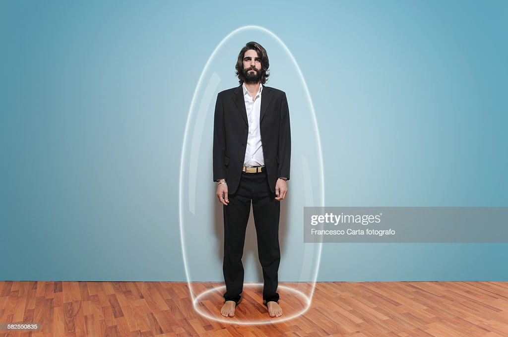 Man inside a large glass test tube : Stock Photo