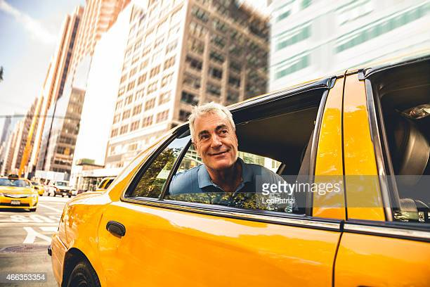 Man inside a taxi in New York downtown