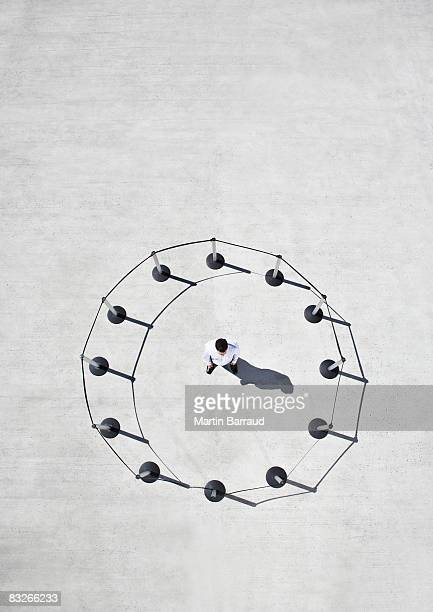 Man inside circle of cordon posts