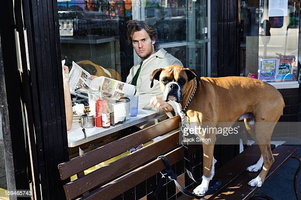 CONTENT] Man inside coffee shop and dog outside Both do not seem happy that I was taking this photo Humor