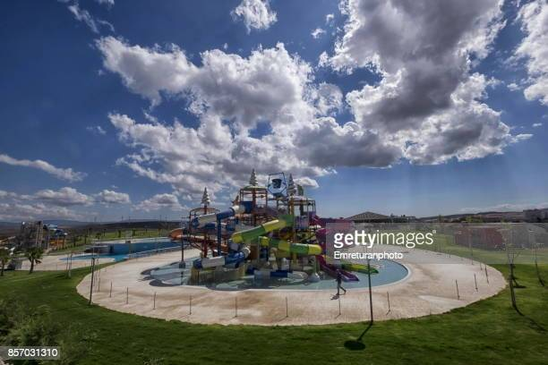 a man inspecting an empty water park equipment under autumn sun in cesme,turkey. - emreturanphoto stock pictures, royalty-free photos & images